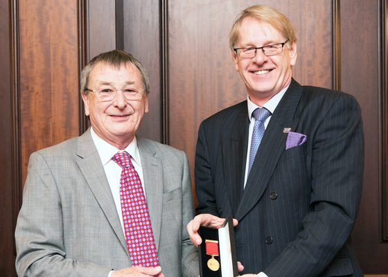 Peter Hoyle receives distinguished service award